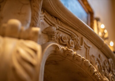 Hard carved travertine fireplace mantle